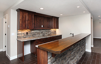Thumb misc  traditional style  knotty alder  dark color  recessed panel  wet bar  raised neck  rock back  wood supports  entertainment area  opening for tv  wood bar top  standard overlay