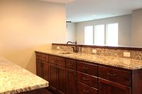 Thumb misc  traditional style  knotty alder  dark stain  recessed panel  wet bar  raised neck  standard overlay