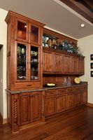 Thumb misc  traditional style  knotty alder  medium color  raised panel  hutch  china  buffet area  glass doors  5 piece top drawers with recessed panels  raised panel backspash  flutes  full overlay  turned posts