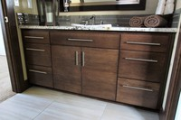 Thumb vanity  contemporary style  quartersawn walnut  dark color  banded door  bank of drawers  single sink  full overlay