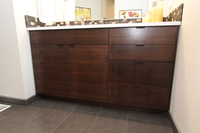 Thumb vanity  contemporary style  quartersawn walnut  dark color  banded doors  single sink  frameless construction