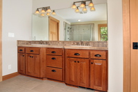 Thumb vanity  craftsman style  cherry  raised panel  light color  angled bump out sinks  master bath  standard overlay