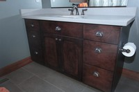 Thumb vanity  craftsman style  hard maple  dark color  recessed panel  single sink  bank of 3 drawers