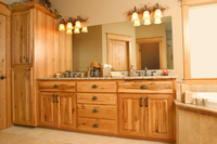 Thumb vanity  rustic style  knotty hickory  light color  raised panel  linen  slab drawer fronts  standard overlay
