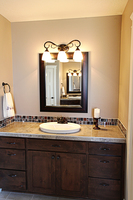 Thumb vanity  shaker style  knotty alder  dark color  recessed panel  standard overlay