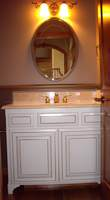 Thumb vanity  traditional style  painted with glaze  raised panel  feet  two small top drawers  standard overlay