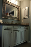 Thumb vanity  traditional style  painted with glaze  wainscot panel  flush mount  medicine cabinet  arched toekick  bevel drawer fronts