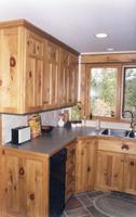 Thumb kitchen  traditional style  knotty pine  light color  t shaped recessed panel doors on uppers  split panel doors on lower cabinets  recessed panel end  standard overly   5 triple step shaker crown