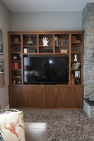 Thumb great room  contemporary style  walnut  medium color  banded door  entertainment  center  wood top  bookcase  built ins  vertical grain  frameless construction