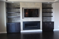 Thumb great room  contemporary style  western maple  recessed panel  dark  black  color  entertainment center  floating shelves  tv above the fireplace   wood tops  built ins  standard overlay