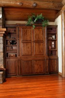 Thumb great room  traditional style  knotty alder  dark color  raised panel  entertainment center  accent color black onlays  bookcase  standard overlay