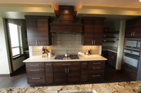 Thumb kitchen  contemporary style  quartersawn walnut  banded door  dark color  custom wood hood  butler pantry  floating shelves  double oven cabinet  full overlay
