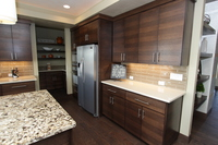 Thumb kitchen  contemporary style  quartersawn walnut  banded door  dark color horizontal grain  butler pantry  floating shelves  double oven cabinet  full overlay