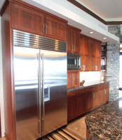 Thumb kitchen  contemporary style  sapele  medium color  recessed panel  appliance garage with top pocket door  full overlay