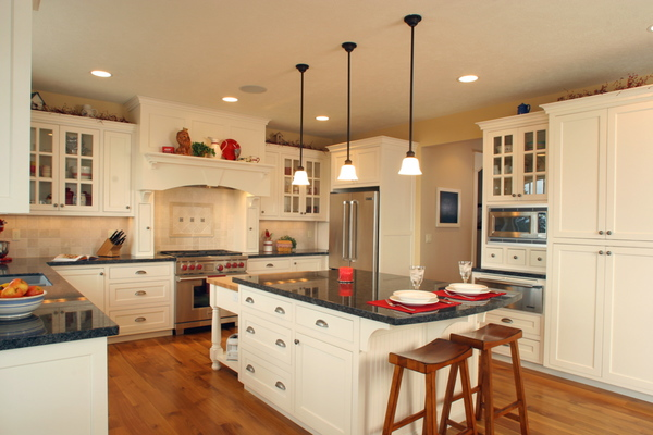 Bigthumb kitchen  craftsman style  painted  recessed panel  flush mount  glass grid doors  wood hood  butcher block top  turned posts   legs  overhang on the end
