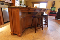Thumb kitchen  craftsman style  quartersawn oak  medium color  flush mount  posts  legs  with wood pegs  mini corbels on island countertop skirt  angled island