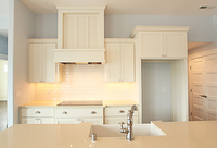 Thumb kitchen  shaker style  painted  wainscot and recessed panel doors  wood hood  staggered heights    13 crown  full overlay