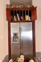 Thumb kitchen  traditional style  cherry  raised panel with arch  cherry color  tray dividers above refrigerator