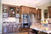 Thumb kitchen  traditional style  knotty alder  dark color  raised panel  plate rods  praire glass grid doors  full overlay