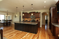 Thumb kitchen  traditional style  knotty alder  dark stain  raised panel  staggered  accent color  black  island  island overhang  standard overlay