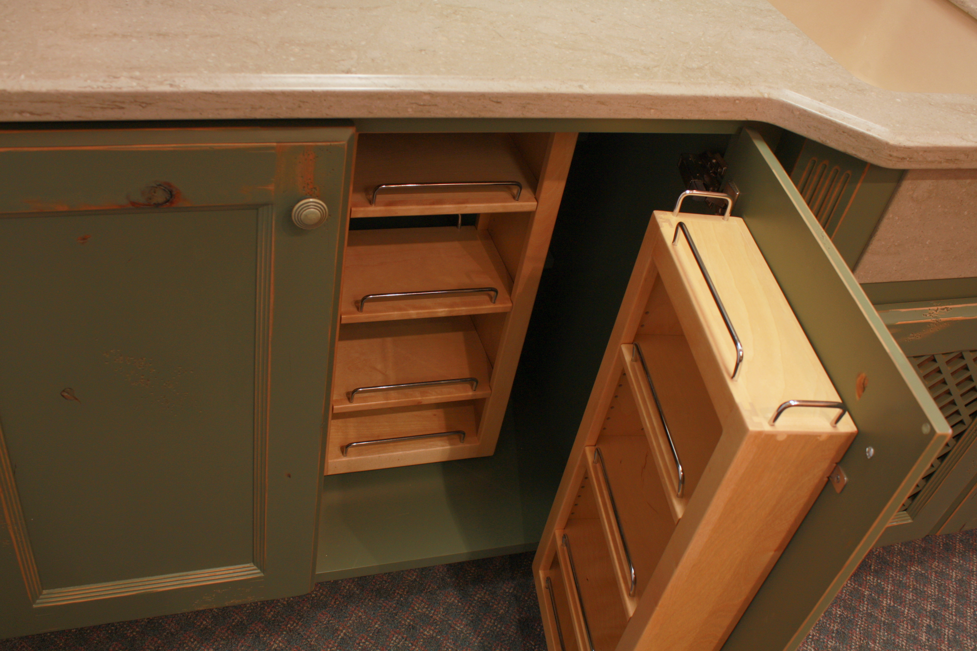 Kitchen  traditional style  knotty alder  green paint with sand through and distress  recessed panel doors  chefs pantry shelves  baking center