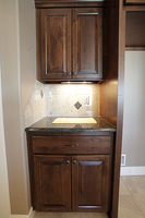 Thumb kitchen  traditional style  knotty alder  raised panel  dark color  drop zone  charging area  standard overlay