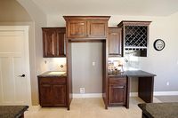 Thumb kitchen  traditional style  knotty alder  raised panel  dark color  wine rack  wine captain space or top only  micro hood  staggered  standard overlay
