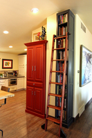 Thumb kitchen  traditional style  painted  raised panel  red  sand through  raised panel  bookcase  dark stain  standard overlay
