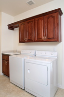 Thumb laundry or utility  traditional style  cherry  raised panel with arch  cherry stain  dry rod  hang rod  towel rod  standard overlay