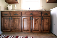 Thumb laundry or utility  traditional style  knotty alder  dark color  raised panel  1 edge full overlay