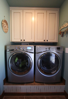 Thumb laundry or utility  traditional style  painted with glaze  recessed panel   6 crown  upper above washer dryer  standard overlay
