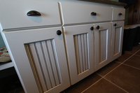 Thumb laundry or utility  traditional style  painted with glaze  wainscot panel doors  full overlay