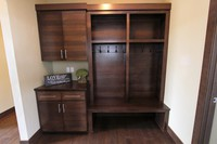 Thumb misc  contemporary style  quartersawn walnut  dark color  banded door  cubbies  lockers  coat hooks  drop off station  bench  square crown  full overlay